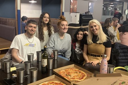 The team enjoying pizza fuelled Friday's