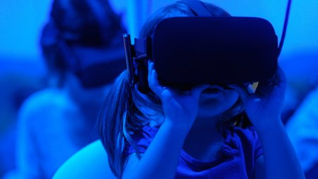 A synergy of human and machine: a child captivated by VR